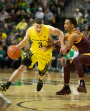 Jan 11, 2020; Eugene, Oregon, USA; Oregon Ducks guard Payton Pritchard (3) drives to the basket against Arizona State Sun Devils guard Alonzo Verge Jr. (11) during the first half at Matthew Knight Arena. Mandatory Credit: Troy Wayrynen-USA TODAY Sports