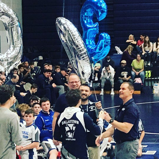 Dallastown wrestling head coach Dave Gable is honored after he collected his 300th career victory on Saturday.