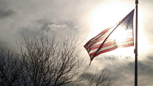 A new flag waves on warm, breezy Sunday morning in West Manchester Township.