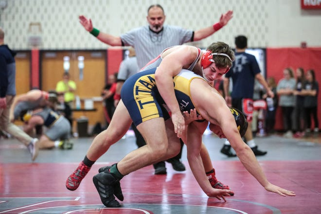 Wes Allen of Canandaigua works Christopher Pannell of Webster Thomas during their 182-pound semifinal at the Bradshaw Tournament on Jan. 11, 2019.