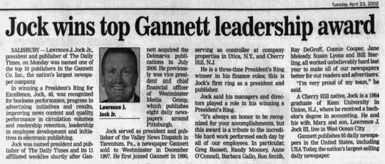 Larry Jock featured in a Daily Times clipping from April 2002, winning a top leadership award from within Gannett.