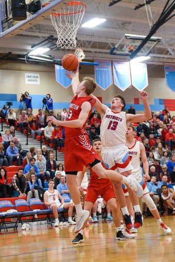 Michael Mors of Yankton blocks a shot by Elliott Hackett of Lincoln on Saturday, Jan. 11, at Lincoln High School in Sioux Falls.