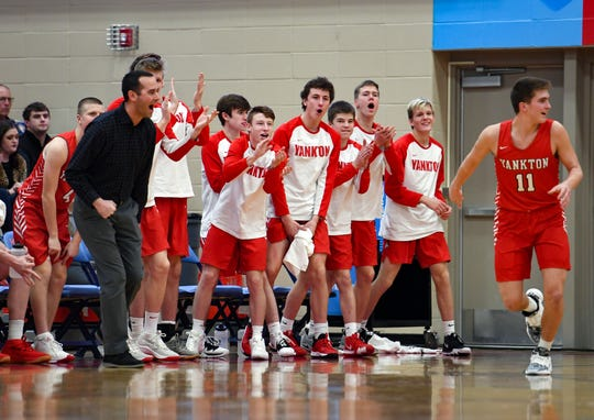 Yankton players celebrate a 3-pointer made by their teammate on Saturday, Jan. 11, at Lincoln High School in Sioux Falls.