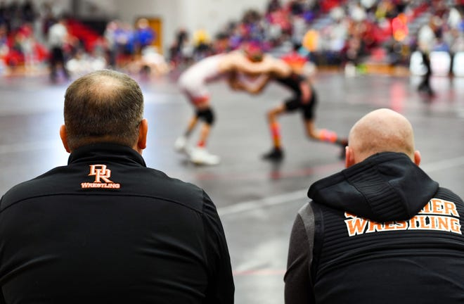 Coach Craig Jorgensen of Dell Rapids, left, watches a match at the Brandon Valley Invitational wrestling meet on Saturday, Jan. 11, at Brandon Valley High School.