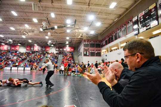Coach Craig Jorgensen of Dell Rapids claps as one of the wrestlers on his team scores a point at the Brandon Valley Invitational wrestling meet on Saturday, Jan. 11, at Brandon Valley High School.