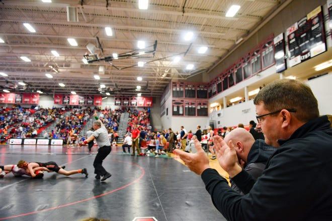 Dell Rapids coach Craig Jorgensen claps at the Brandon Valley Invitational wrestling meet last season.