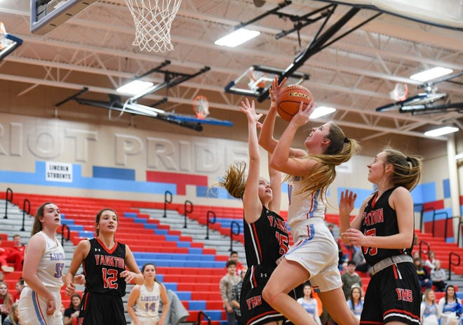 Morgan Hansen of Lincoln jumps to make a basket during a game against Yankton on Saturday, Jan. 11, at Lincoln High School in Sioux Falls.