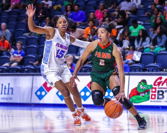 FAMU freshman Alaina Rice goes baseline by Nina Rickards of Florida. Rice is the top scorer for the Rattlers.