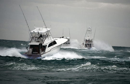 Boats head to sea Thursday during the second day of fishing in the Pelican Yacht Club Billfish Invitational.