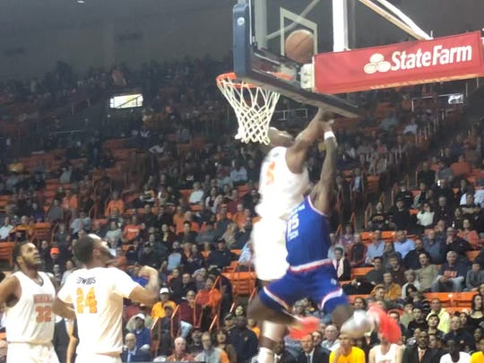 UTEP's Bryson Williams blocks the shot of Louisiana Tech's DaQuan Bracey Saturday night at the Don Haskins Center