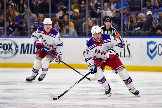 Jan 11, 2020; St. Louis, Missouri, USA;  New York Rangers defenseman Tony DeAngelo (77) handles the puck during the first period against the St. Louis Blues at Enterprise Center. Mandatory Credit: Jeff Curry-USA TODAY Sports