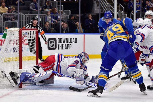 Jan 11, 2020; St. Louis, Missouri, USA;  New York Rangers goaltender Henrik Lundqvist (30) dives to make a save against St. Louis Blues center Ivan Barbashev (49) during the second period at Enterprise Center. Mandatory Credit: Jeff Curry-USA TODAY Sports