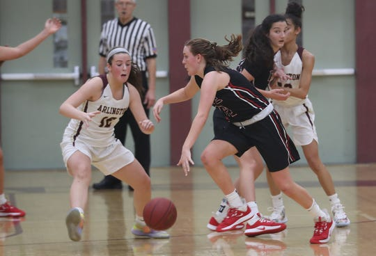 Rye's Teaghan Flaherty (12) tries to get around Arlington's Molly Stephens (12)  during girls basketball action at Arlington High School in Freedom Plains Jan. 11, 2020. Arlington won the game 67-60.