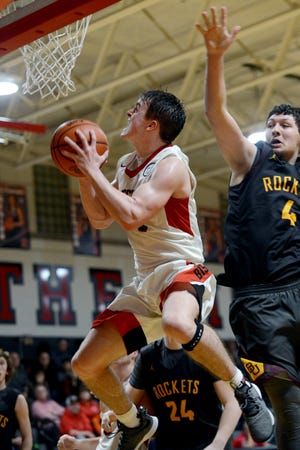 Weston Nern soars through the lane for two of his game-high 20 points in Rosecrans' 60-44 win against vsiting Berne Union on Saturday night at Rogge Gymnasium.