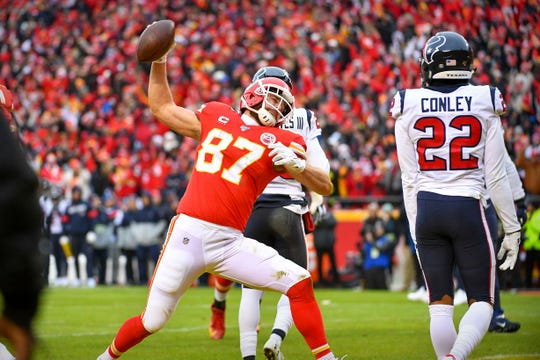 Kansas City Chiefs tight end Travis Kelce scores a touchdown against the Houston Texans during the second quarter in a AFC Divisional Round playoff football game at Arrowhead Stadium.