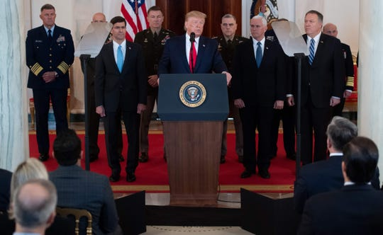 President Donald Trump and his national security team at the White House in Washington, D.C., on Jan. 8, 2020.