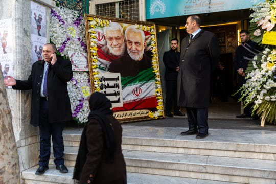 Photos of Gen. Qasem Soleimani outside his memorial service in Tehran on Jan. 12, 2020.