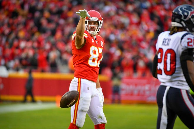 Kansas City Chiefs tight end Travis Kelce (87) celebrates a first down against the Houston Texans during the second quarter in a AFC Divisional Round playoff football game at Arrowhead Stadium.