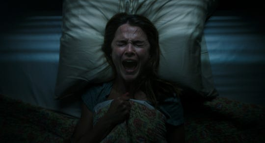 "An Oregon teacher (Keri Russell) is among those freaked out when a mythological creature goes on a bloody rampage in ""Antlers."""