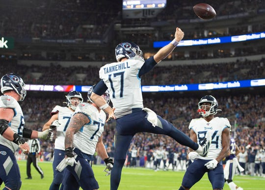 Tennessee Titans quarterback Ryan Tannehill celebrates after scoring a touchdown against the Baltimore Ravens.