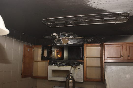 A sprinkler system kept a fire inside a vacant apartment in the 400 block of North Richmond Street contained Monday morning.