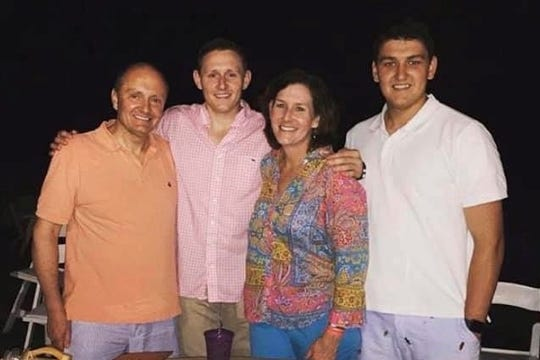 Kevin Conery, left, with his wife, Maureen, and sons Joseph and Ryan.