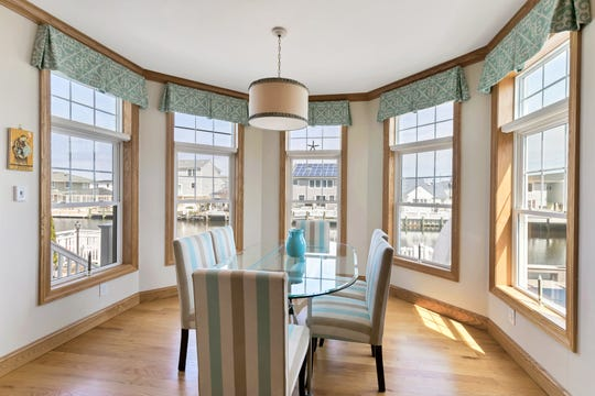 The dining room features custom windows and tray ceilings.