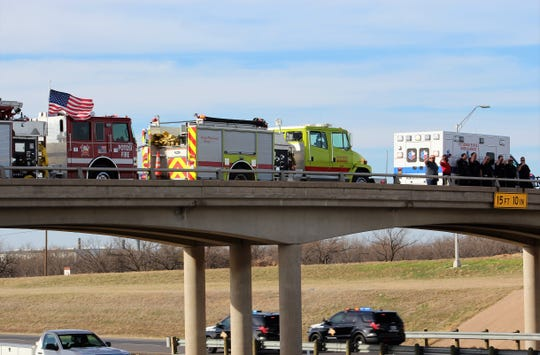 First responders salute vehicles returning to Lubbock from Fort Worth with the bodies of two fallen Lubbock County first responders. Abilene, Eula and Potosi firefighters, along with Callahan County ambulance personnel, honored their peers as westbound vehicles passed under the Buck Creek Road overpass in west Callahan County. Jan. 13 2020