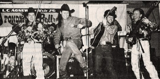 Neal McCoy, second from left, gets a leg up on the competition during his January 1993 show at the Ponderosa Ballroom.