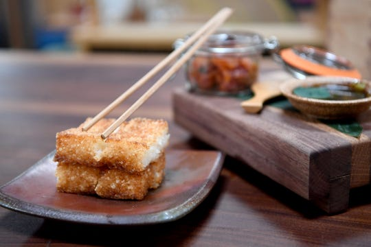 The rice crispy squares at Futo Buta in downtown Asheville is spicy tuna, crispy fried rice and served with a wasabi soy sauce.