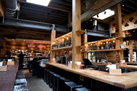"""Futo Buta, on Biltmore Avenue in downtown Asheville, describes itself as a """"rock n' roll ramen shop"""" and serves up a menu with an homage to the history of ramen in a color setting."""