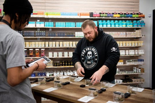 Shane Phillips, right, shops for recreational marijuana on Monday, Jan. 13, 2020 at the Battle Creek Provisioning Center in Battle Creek. The provisioning center, located at 2245 W Columbia Ave., received its local license and is now selling recreational marijuana.