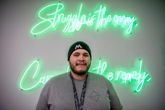 Store manager Carlos Garrido on Monday, Jan. 13, 2020 at Battle Creek Provisioning Center in Battle Creek. The provisioning center, located at 2245 W Columbia Ave., received its local license and is now selling recreational marijuana.