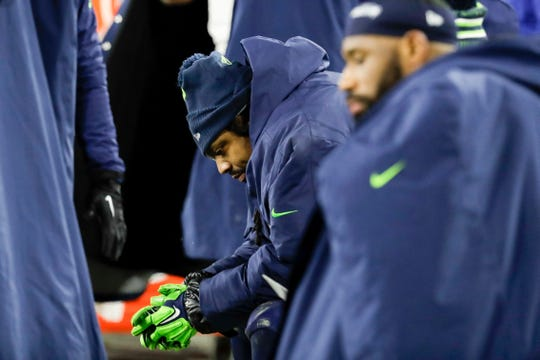 Seattle's Marshawn Lynch sits on the bench during the second half an NFL divisional playoff football game against the Packers. Despite two TD carries by Lynch, the Packers won 28-23 to advance to the NFC Championship.