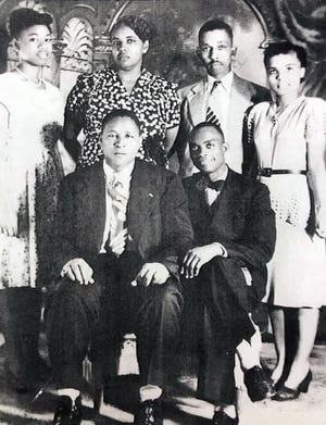 Evangeline Moore, left, with mother Harriette V. Moore, father Harry T. Moore, a friend and two NAACP officials at the state conference in Daytona in the 1940s.