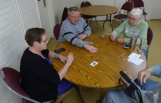 Jackie Davidson, Ed Grove and Emma Scroggins play euchre Thursday at the Galion Golden Age Center. The games, offered twice a week, are open to the public.