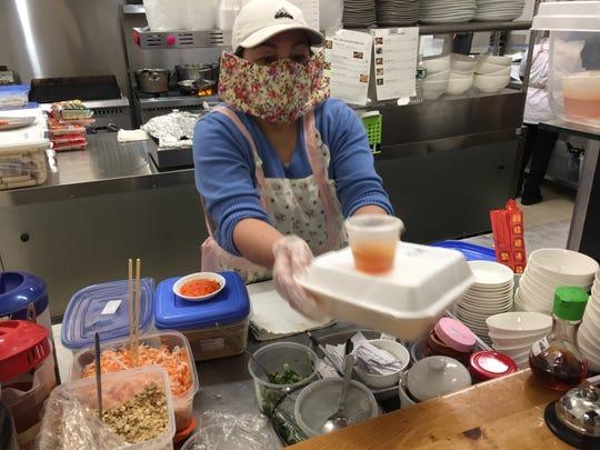 Jennie Nguyen prepares a take-out order Jan. 10, 2020 at Saigon Kitchen in Burlington.