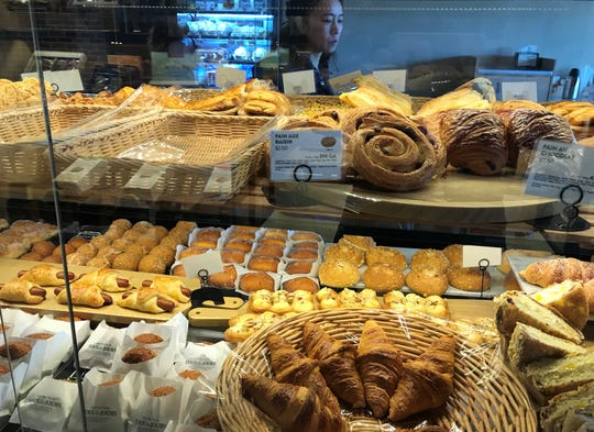 A glass case holds pastry selections at Tous Les Jours, a new bakery in Cherry Hill.