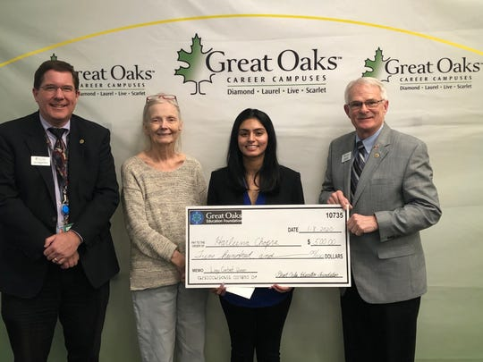 From left: Great Oaks Dean of Satellite Programs Ted Kirkpatrick, Harleena Chopra, Great Oaks Board member Debbie Delp of Mason, and Board member Jim Perdue of Reading.