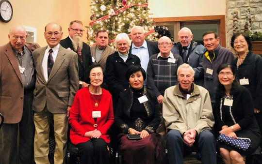 Standing: Bob McGeorge, Dr. Lee Bae-Suk, Dewey Bond, Tom Whited, Barbara Rettig, Joe Rettig, Tommy Whitehead, Bill Doud, Lee Youngjun, and Lee Youngae. Sitting: Mrs. Lee, Kim Hwal Ran, Don Kleingers, and Insook Kim.
