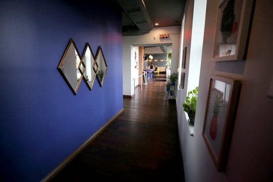 View of the hallway connecting the main dining room and the bar, pictured, Friday, Jan. 10, 2020, at Goose and Elder in Cincinnati.
