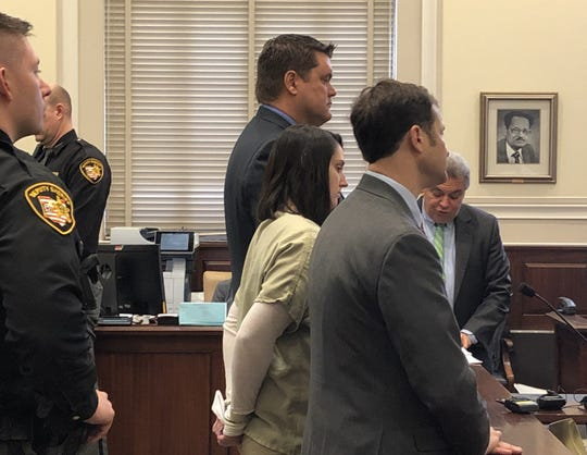 Britney Mayes stands between her attorneys, Will Welsh, to her left, and Scott Rubenstein, in Hamilton County Common Pleas Court Monday, Jan. 13, 2020. Mayes pleaded guilty to aggravated murder in the 2016 death of her 4-year-old daughter, Averylee.