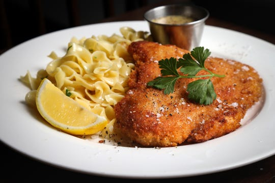 The chicken schnitzel, served with buttered noodles and grain mustard, pictured, Friday, Jan. 10, 2020, at Goose and Elder in Cincinnati.