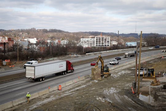 Construction continues along Interstate 75, between the Hopple Street and Mitchell Avenue exits, Monday, Jan. 13, 2020. The Ohio Department of Transportation (ODOT) is on stage five of the 12-step, $87 million Mill Creek Expressway project, adding a fourth lane to I-75 between Hopple Street and Mitchell Street.