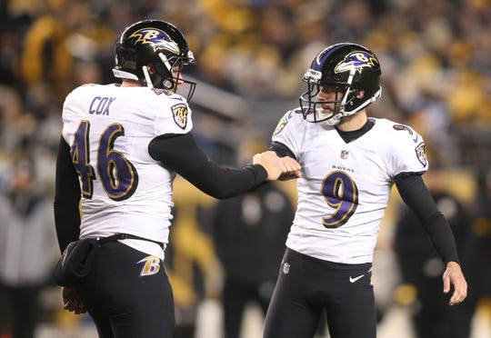 Dec. 10, 2017: Baltimore Ravens long snapper Morgan Cox (46) and kicker Justin Tucker (9) celebrate an extra point conversion against the Pittsburgh Steelers at Heinz Field.