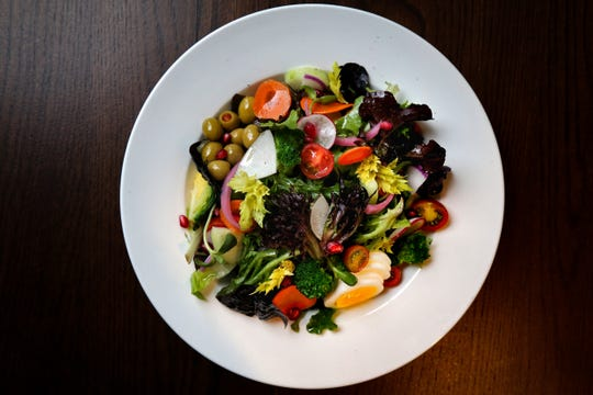 The big salad, with farm greens, seasonal vegetables, hard-boiled egg, cheery tomatoes, olives and house vinaigrette, offered with grilled chicken, pictured, Friday, Jan. 10, 2020, at Goose and Elder in Cincinnati.