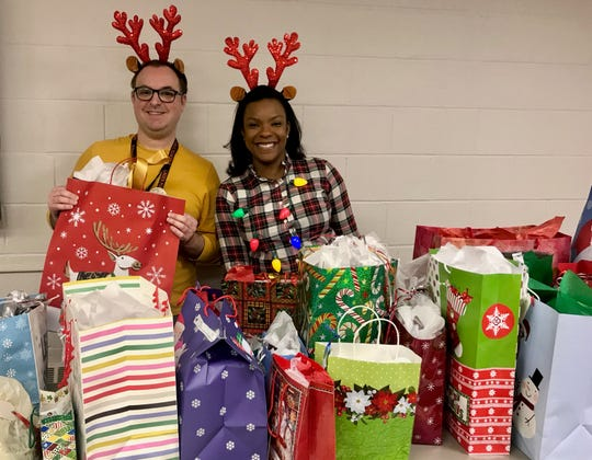 Linden High School social worker Ryan Devaney and Linden Public Schools Supervisor of Student Services Annabell Louis sorting gifts to be delivered to local families for the district's holiday gift drive.