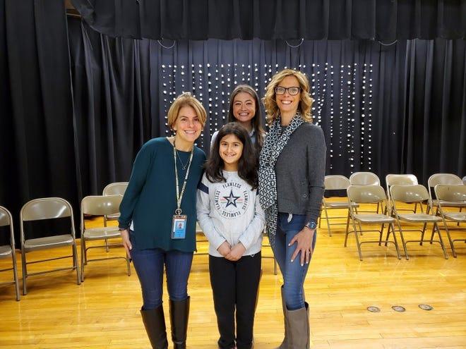 (Left to right) Alison Korner, fourth-grade teacher; Isha Gidwani, winner, Carolyn Mills, STEM & G&T Teacher; and Jill Dobrowansky, principal.