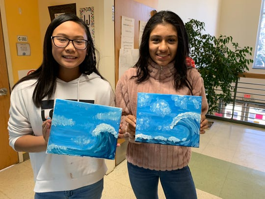 Kayla Le of South Plainfield and Avni Vasani of Scotch Plains proudly display the artwork they learned to create during the Teacher-for-a-Day program.