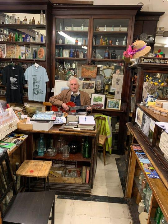 A man sings a Gaelic ballad in Sweny's Chemist Shop in Dublin, Ireland.